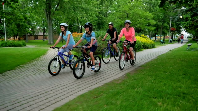 family healthy lifestyle: bicycling together - riding stock videos & royalty-free footage