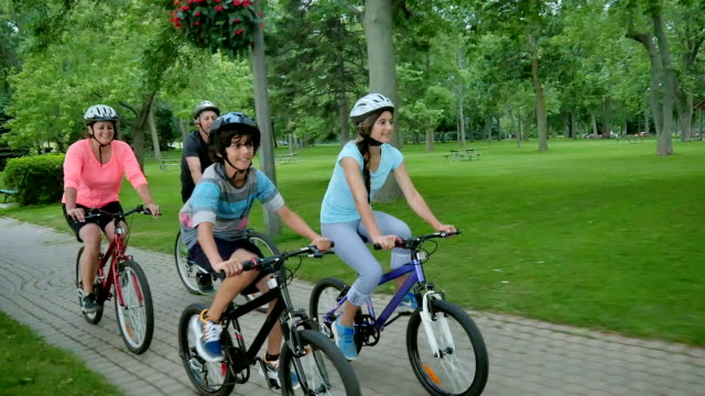 family healthy lifestyle: bicycling together - fatcamera stock videos and b-roll footage