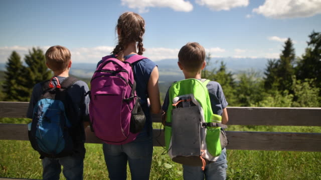 family hiking in beautiful mountains - high up stock videos & royalty-free footage