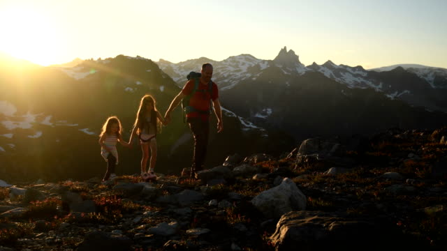 family hiking in the mountains - mountain peak stock videos and b-roll footage