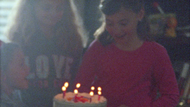 family home video of little girl with birthday cake on film. - 8 9 years stock videos and b-roll footage