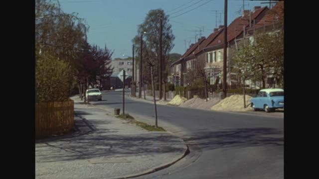 family homes in weimar, typical gdr buildings, boy with bycicle drives through the streets, typical car trabant in front of a building lot, inside a... - weimar stock videos & royalty-free footage