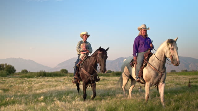 family horseback riding in the fields - ranch family stock videos & royalty-free footage