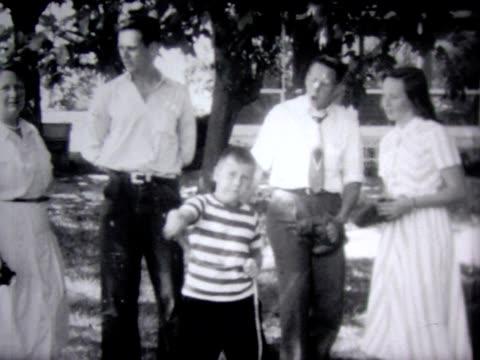 stockvideo's en b-roll-footage met 1948 family horsing around - compleet pak