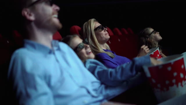vídeos de stock e filmes b-roll de family in a movie theater. - film industry