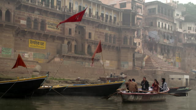 family in a small boat passing in front of digpatiya gath - uttar pradesh stock videos & royalty-free footage
