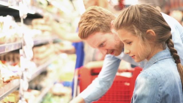 family in a supermarket, 4k - shopping basket stock videos and b-roll footage
