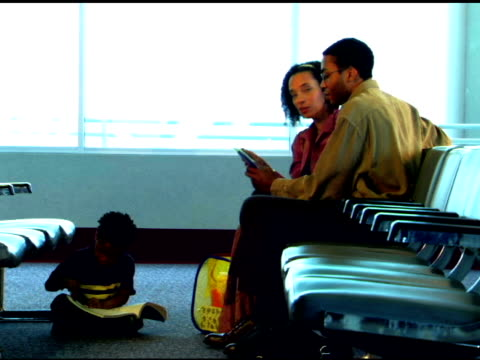 family in airport - sitting stock videos & royalty-free footage