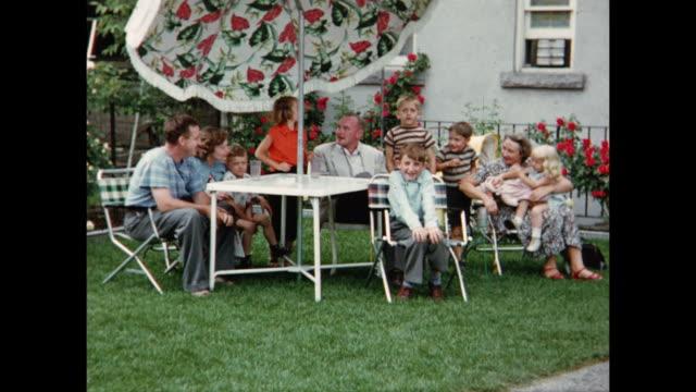 1955 WS Family in backyard, posing for camera / Toronto, Canada