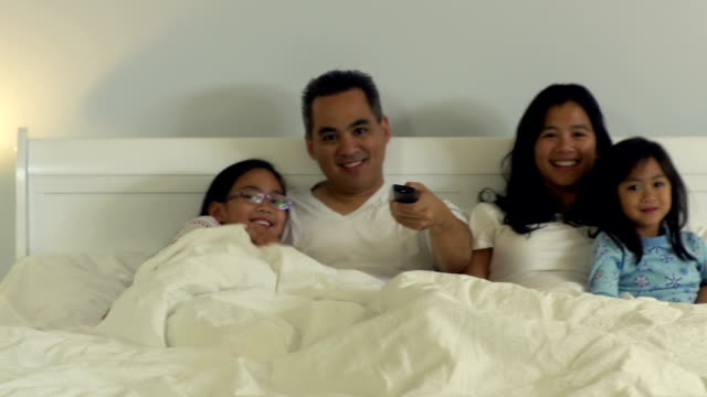 family in bed together - duvet stock videos & royalty-free footage