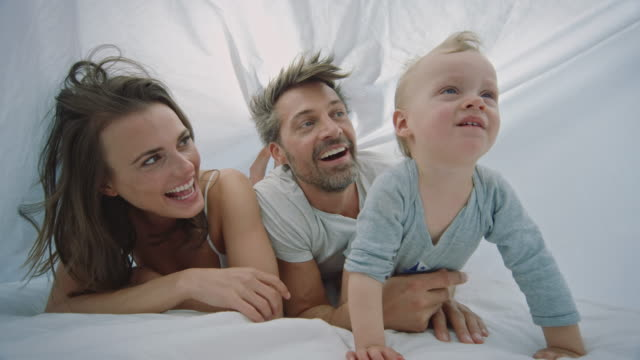 family in bed - spain stock videos & royalty-free footage