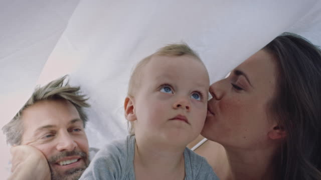 family in bed - duvet stock videos & royalty-free footage