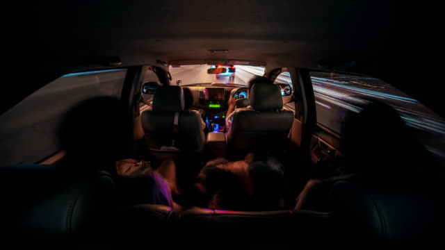 family in car road trip night city time lapse - car interior stock videos & royalty-free footage
