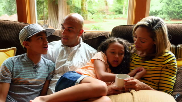 ms family in discussion on couch in living room - pacific islander family stock videos & royalty-free footage