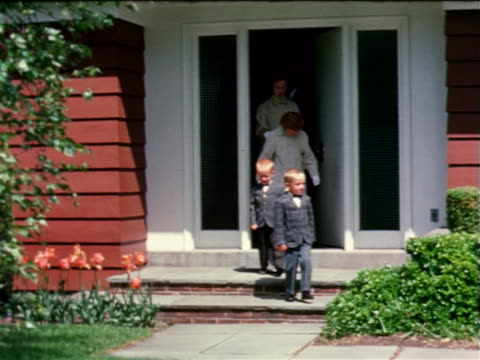 1963 family in formalwear exiting house / near Rochester, NY / industrial