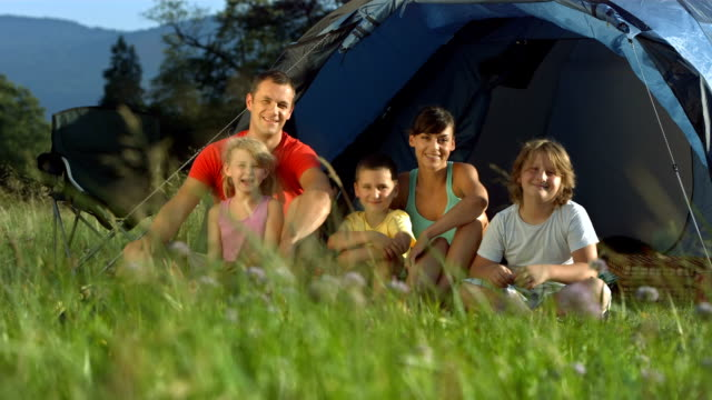 hd dolly: family in front of a tent - family with three children stock videos & royalty-free footage