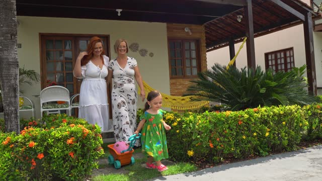 family in front of the summer house - female friendship stock videos & royalty-free footage