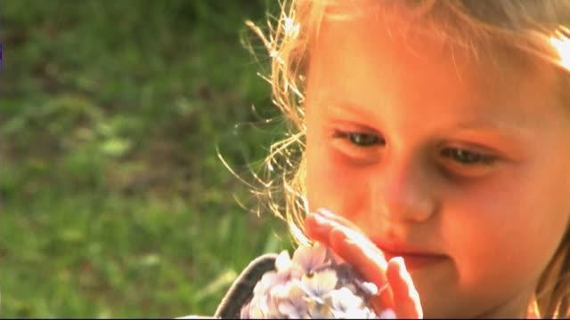 vídeos y material grabado en eventos de stock de family in park, mother and daughter with flower - hortensia