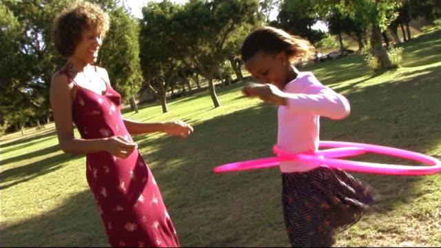 family in park with hula hoop - plastic hoop stock videos & royalty-free footage