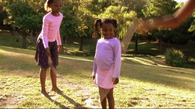 family in park with skipping rope - jump rope stock videos and b-roll footage