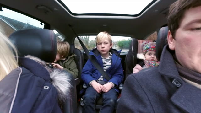 family in the car - family with three children stock videos & royalty-free footage