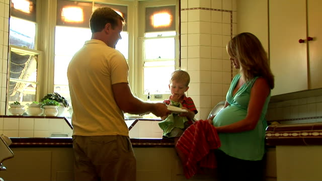 family in the kitchen - security blanket stock videos & royalty-free footage