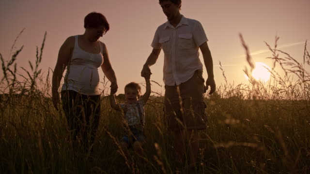 SLO MO Family in the meadow at sunset