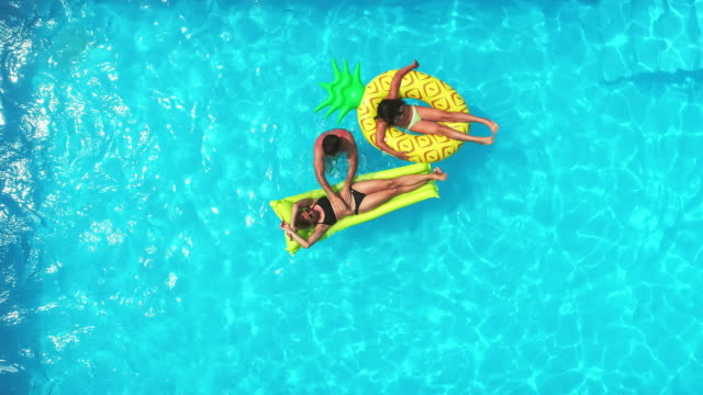 family in the pool - inner tube stock videos and b-roll footage
