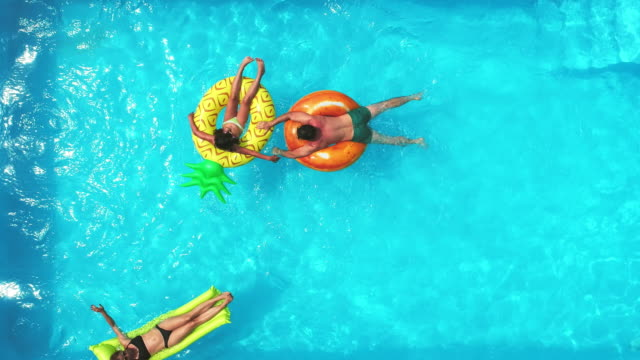 family in the pool - rubber ring stock videos & royalty-free footage