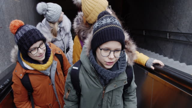 family in vienna metro escalator - railway station stock videos & royalty-free footage
