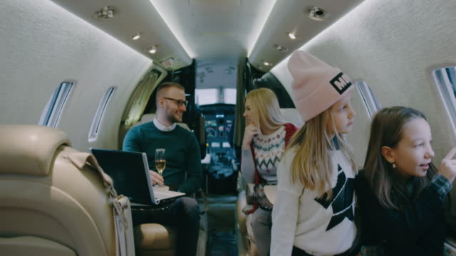 family inside private airplane - multi generation family stock videos & royalty-free footage