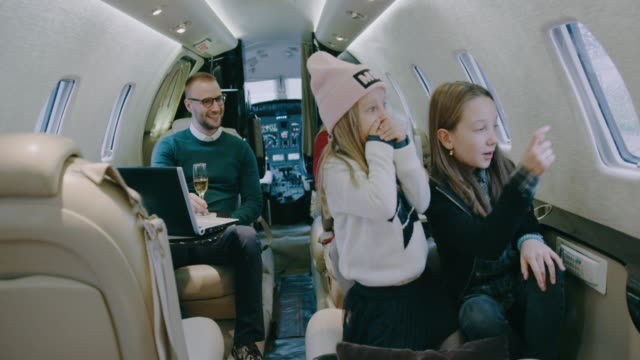 Family inside private airplane
