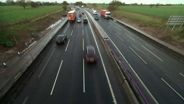 Family involved in crash highlight dangers of smart motorways ENGLAND Cheshire from car as along M6 motorway next to concrete barrier barring access...