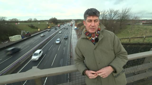Family involved in crash highlight dangers of smart motorways ENGLAND Cheshire EXT INT Various of Duncan Montgomery reading book to his three...