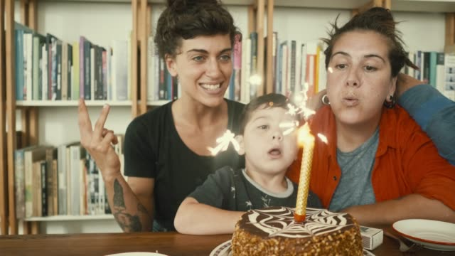lgbt family is having a birthday (slow motion) - homosexual stock videos & royalty-free footage