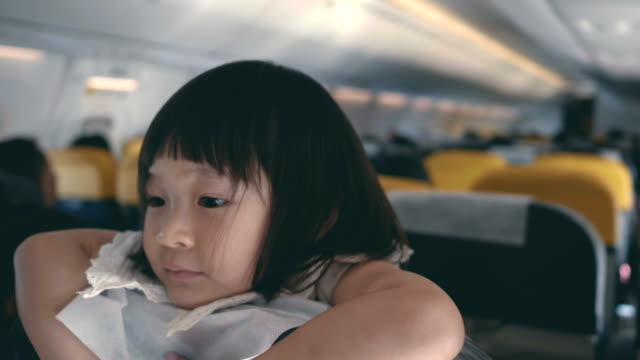 family journey  : daughter fly on the plane - passenger stock videos & royalty-free footage