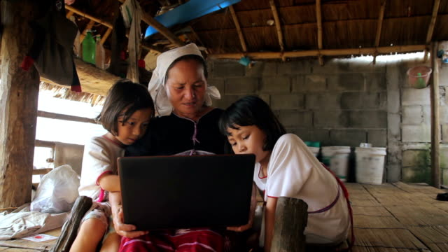 family karen enjoys learning to use a laptop,dolly shot - indigenous culture stock videos & royalty-free footage