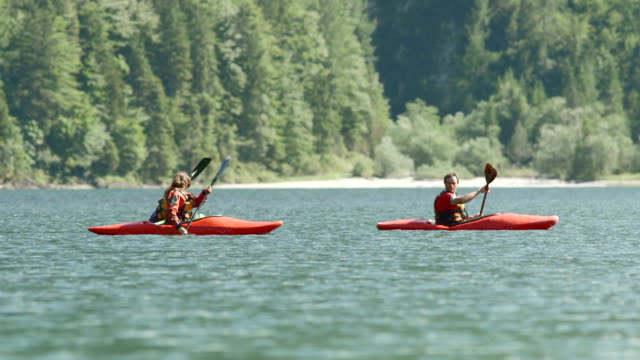 hd: family kayaking on the lake - canoeing stock videos and b-roll footage