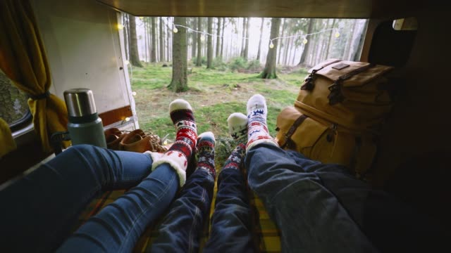 family laying in camper van in christmas socks - furgone video stock e b–roll