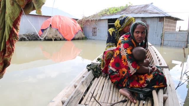 a family leads life on boat in a flood affected area in lalmonirhat district bangladesh on july 15 2017 flooding sparked by heavy seasonal rains and... - indian mom stock videos & royalty-free footage