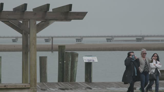 family leaves the boardwalk amidst pandemic related restrictions on march 28, 2021 in chincoteague, virginia. there have been 546,299 covid-19 deaths... - street name sign stock videos & royalty-free footage