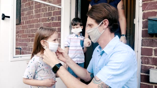 family leaving home during the covid-19 pandemic - surgical mask stock videos & royalty-free footage
