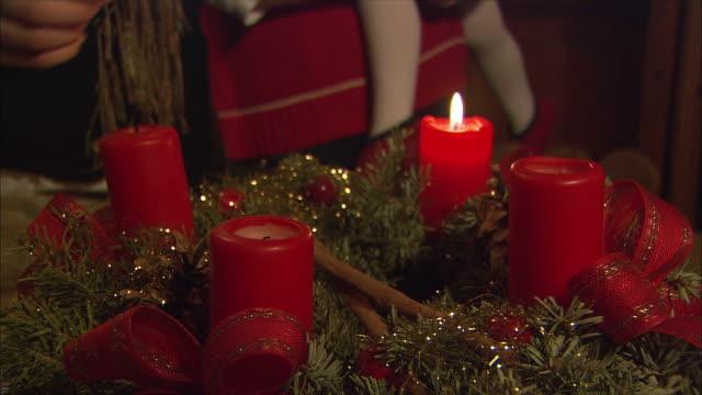 cu family lighting christmas candles / near salzburg, austria - österreichische kultur stock-videos und b-roll-filmmaterial