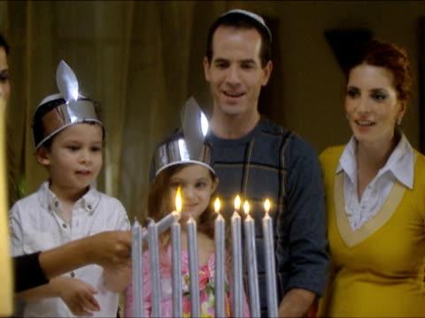 zi zo ms family lighting hanukkah candles / beit yitzhak, israel - judaism stock videos & royalty-free footage