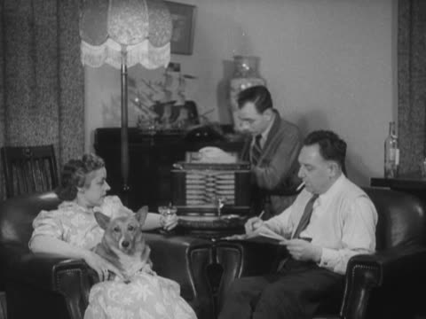 a family listen to the general election results on a radio in a living room - bbc archive stock-videos und b-roll-filmmaterial
