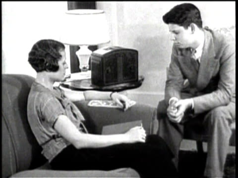 a family listens to the radio / fdr speaks / a young couple listens to their radio / fdr continues his speech / - radio stock videos & royalty-free footage