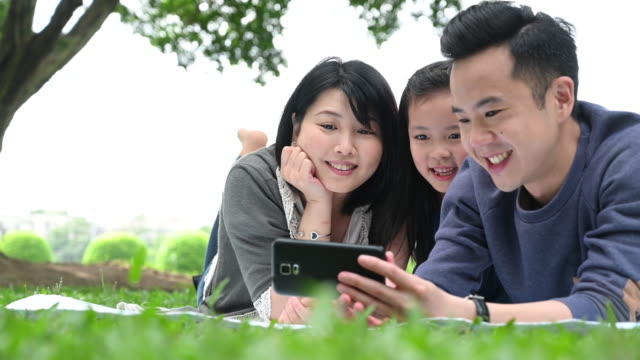 family looking surprised and happy at smart phone - taipei stock videos & royalty-free footage