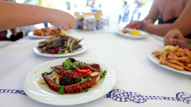 family lunch in the restaurant to the beach - greece stock videos & royalty-free footage