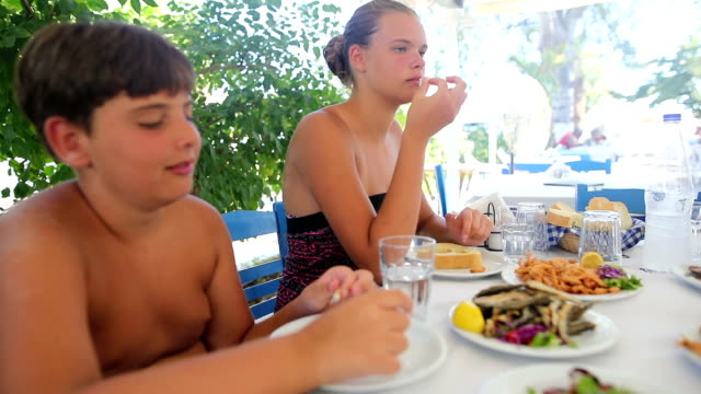 Family lunch in the restaurant to the beach
