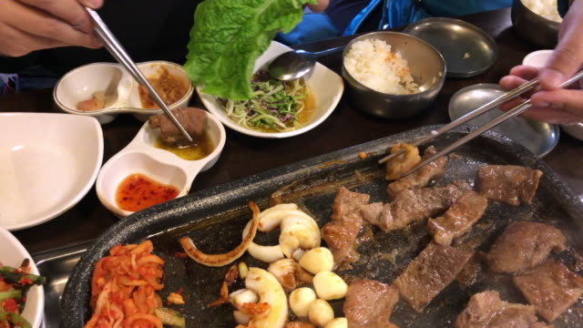 family lunch time with korean bbq , seoul , south korea - korea stock videos & royalty-free footage